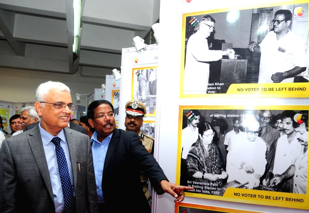 Chief Election Commissioner Om Prakash Rawat during an exhibition and painting competition on Assembly elections organised at Karnataka Chitra Kala Parishath, in Bengaluru on April 5, 2018.