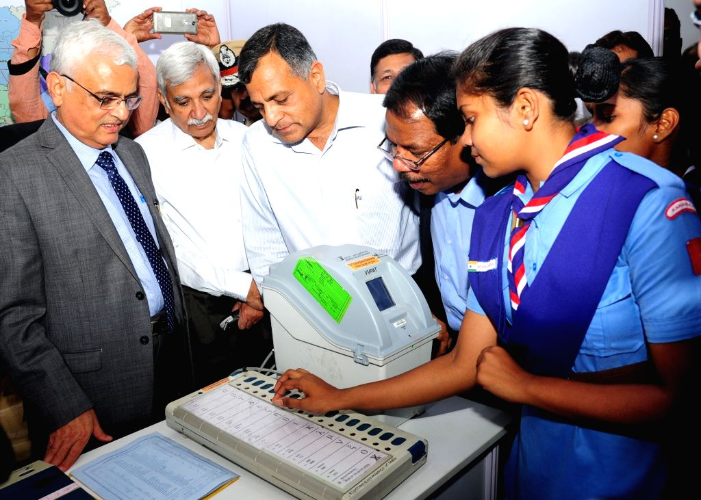 Chief Election Commissioner Om Prakash Rawat and Election Commissioner Ashok Lavasa during an exhibition and painting competition on Assembly elections organised at Karnataka Chitra Kala ...