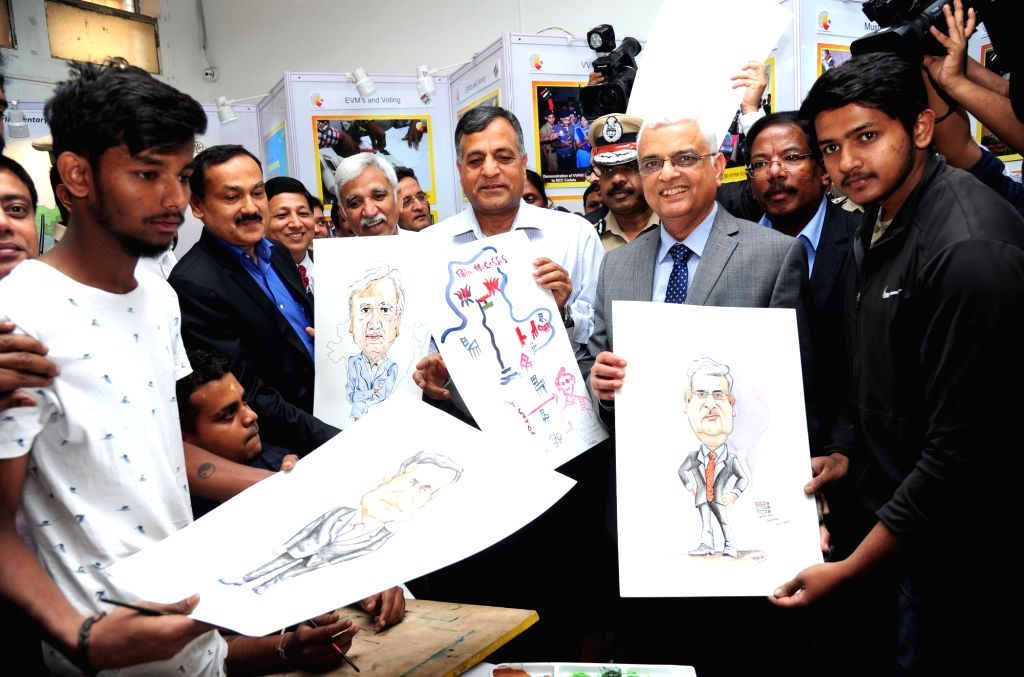 Chief Election Commissioner Om Prakash Rawat with Election Commissioner Ashok Lavasa and Karnataka Chief Election Commissioner Sanjiv Kumar during an exhibition and painting competition on ...