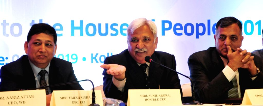 Chief Election Commissioner Sunil Arora accompanied by West Bengal's Chief Electoral Officer Aariz Aftab and Election Commissioner Ashok Lavasa, addresses a press conference in Kolkata, on ...