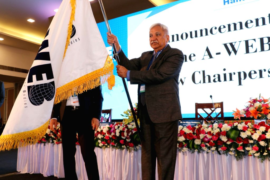 Chief Election Commissioner Sunil Arora after being handed over the Association of World Election Bodies (AWEB) flag by its incumbent Chairman from Romania, Lon Mincu Radulescu, as the ...