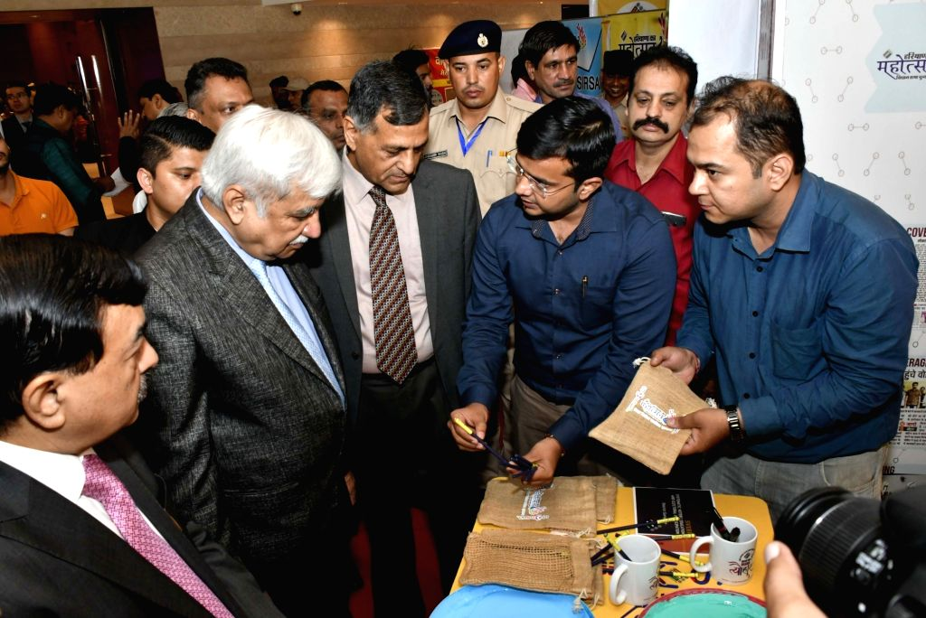 Chief Election Commissioner Sunil Arora and Election Commissioners Ashok Lavasa and Sushil Chandra the stalls set up by all District Election Officers of the State and inquired in detail ...