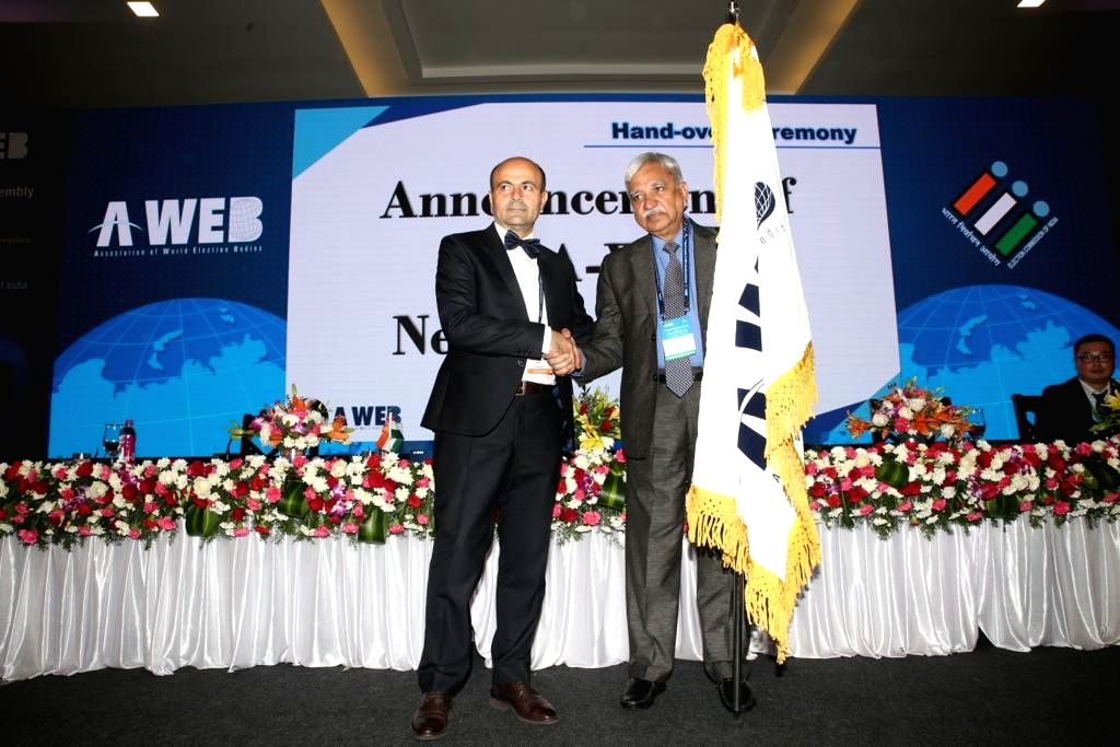 Chief Election Commissioner Sunil Arora being handed over the Association of World Election Bodies (AWEB) flag by its incumbent Chairman from Romania, Lon Mincu Radulescu, as the former ...