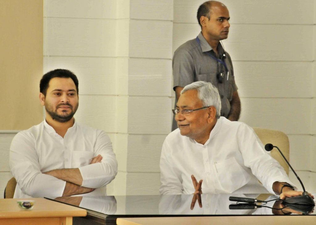 Chief Minister Nitish Kumar and Deputy Chief Minister Tejashwi Yadav during a programme in Patna on July 3, 2017​. - Nitish Kumar and Tejashwi Yadav