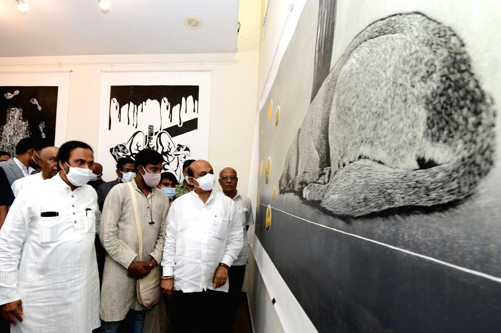 Chief Minister of Karnataka Basavaraj Bommai looking at Gandhi principles artworks on the occasion of Gandhi Jayanthi at Chitrakala Parishat, in Bengaluru on Saturday 2021 ... - Dhananjay Yadav