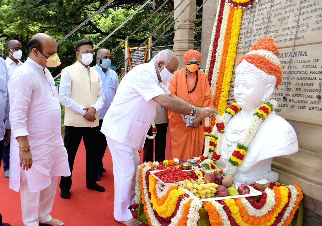 Chief Minister of Karnataka BS Yeddiyurappa with Home Minister Basavaraj Bommai and others paid floral tribute to Sri Basaveshwara statue on the occasion of Basaveshwara Jayanthi, in ... - Basavaraj Bommai