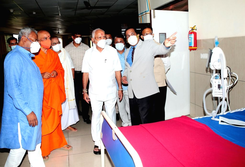 Chief Minister of Karnataka BS Yeddyurappa inaugurating the 210 Oxygen Beds, 43 ICU Beds, 30 Beds and 100 common beds COVID care center at BGS Global Institute of Medical Sciences and ...