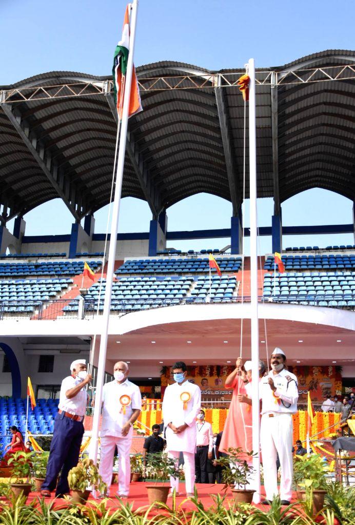 Chief Minister of Karnataka BS Yeddyurappa and Minister Suresh Kumar paying floral tribute to Nada Devate Bhuvaneshwari  during Kannada Rajyotsava celebrations at Kanteerava Stadium, in ... - Suresh Kumar