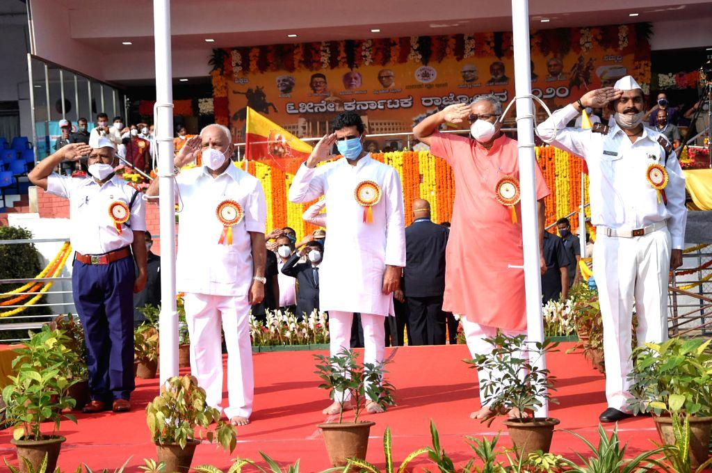 Chief Minister of Karnataka BS Yeddyurappa and Minister Suresh Kumar hosting Karnataka state flag  and National flag during Kannada Rajyotsava celebrations at Kanteerava Stadium, in ... - Suresh Kumar
