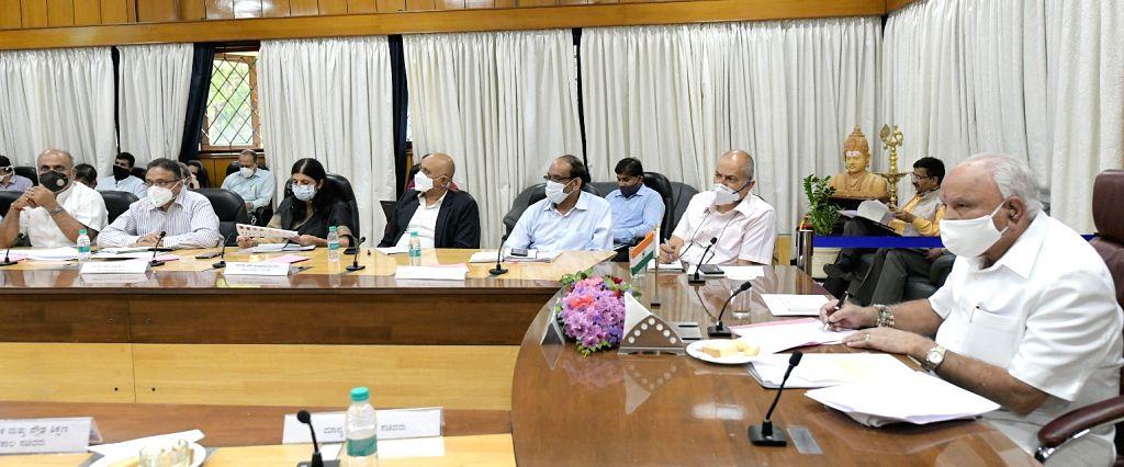 Chief Minister of Karnataka BS Yeddyurappa with Ministers R Ashoka, Suresh Kumar, Sudhakar, Gopalaiah and health dept. officials during a meeting on COVID-19, in Bengaluru on Monday 29th ... - R Ashoka, Suresh Kumar, Sudhakar and Gopalaiah