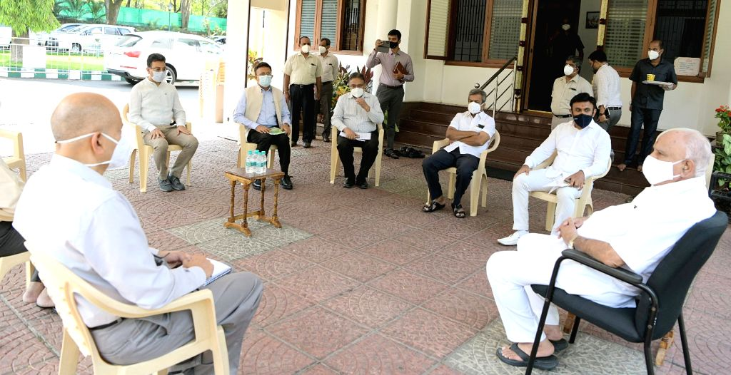 Chief Minister of Karnataka BS Yeddyurappa with Medical Education Minister Sudhakar, Chief Secretary Ravi Kumar and officials during a meeting COVID-19 status at his official residence ( ... - Sudhakar and Secretary Ravi Kumar