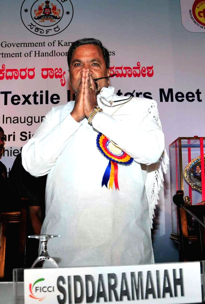 Chief Minister Siddaramaiah releases ``Nuthana Javali Neeti`` booklet with Minister Baburao Chinchansur, Anand Sudarshan, Co Chairman and K Ratna Prabha, Additional Chief Secretary - Commerce and ...