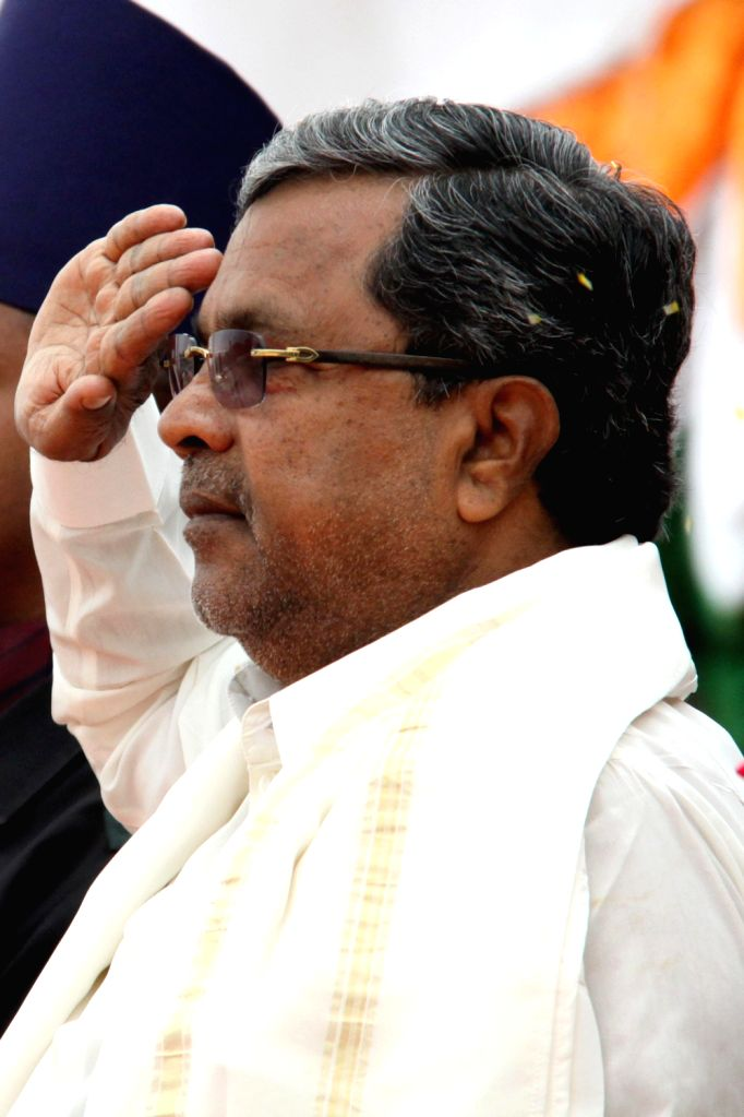 Chief Minister Siddaramaiah takes salute during Independence Day Pared at Manekshaw Parade Ground, in Bangalore on Thursday 15th August 2013. (Photo::: IANS)