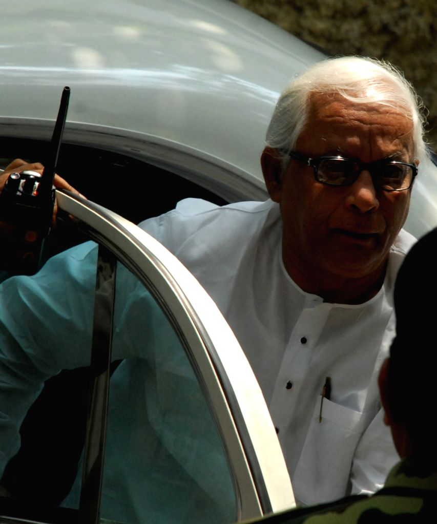Chief Minsiter Budhadeb Bhattachrya getting down of his car to cast his vote on the Parliamentary Election day on 13th May 2009.
