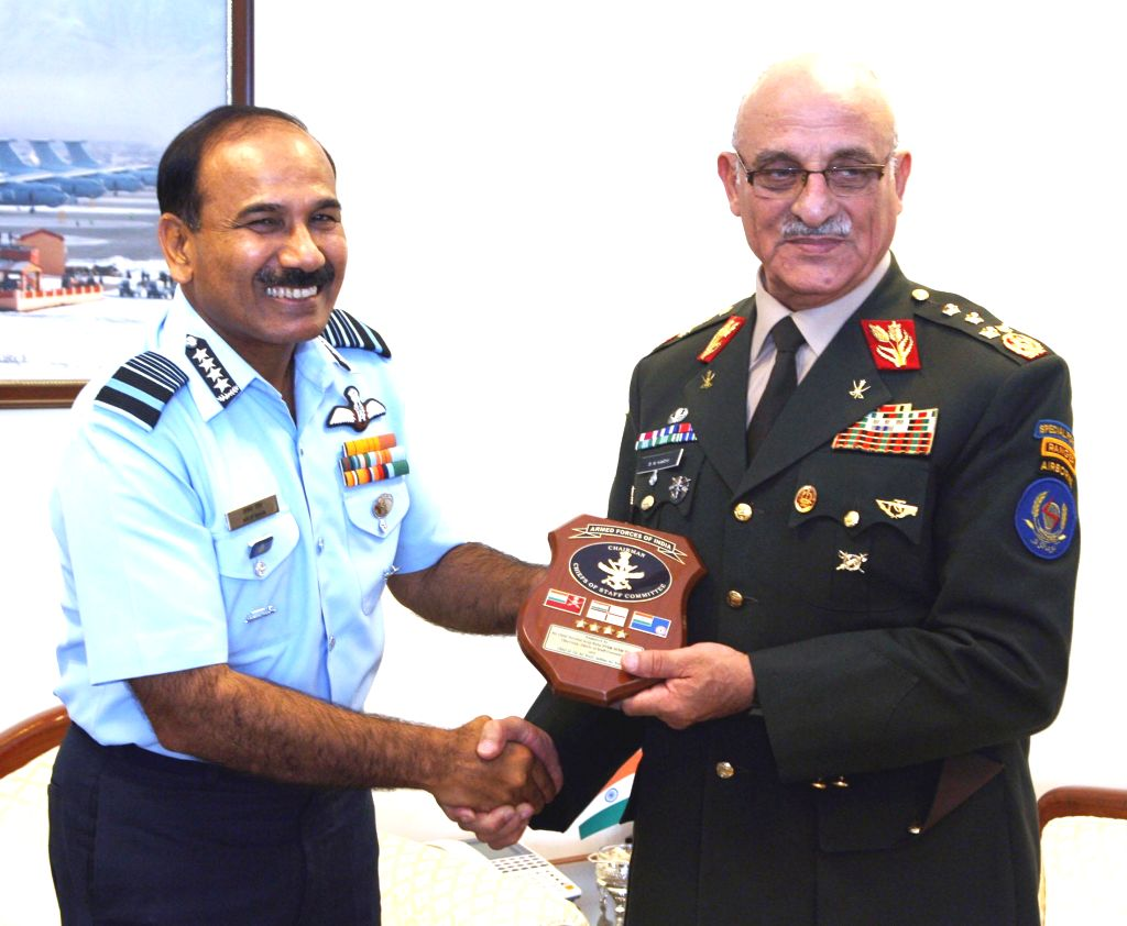 Chief of Air Staff, Air Chief Marshal Arup Raha presents a memento to the Chief of General Staff, Afghan National Army, General Sher Mohammad Karimi, in New Delhi on August 21, 2014.