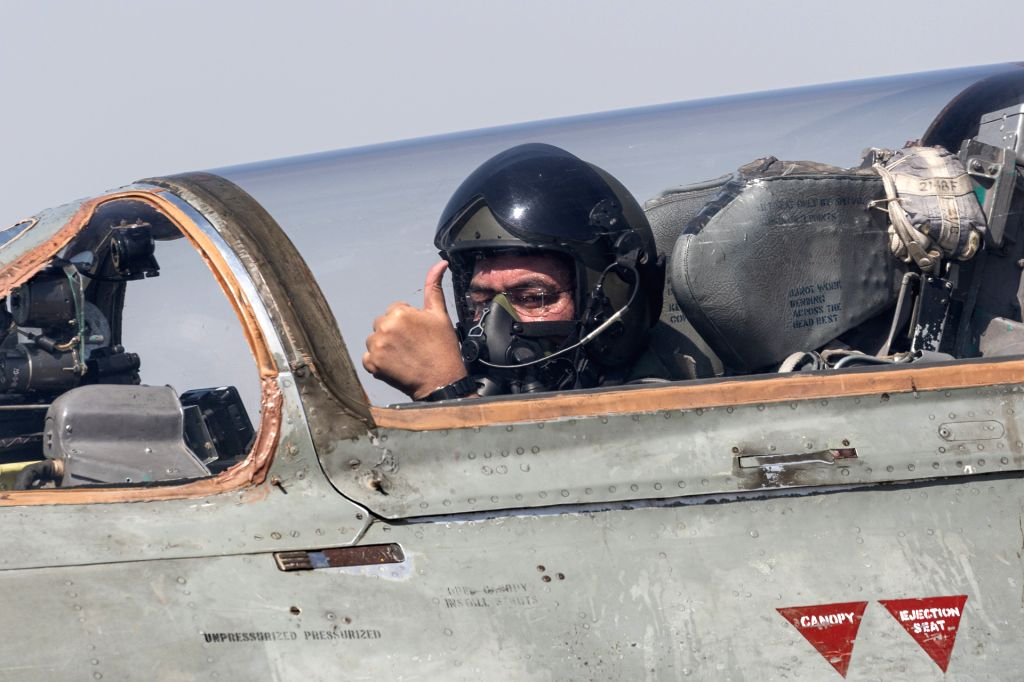 Chief of the Air Staff, Air Chief Marshal B.S. Dhanoa preparing to take off during a four aircraft, MiG-21 'Missing Man' formation flypast to honour the valour and supreme sacrifice of men ...