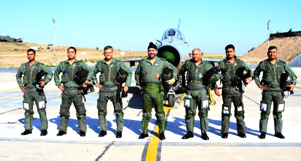 Chief of the Air Staff, Air Chief Marshal B.S. Dhanoa and Air Officer Commanding-in-Chief Western Air Command Air Marshal R. Nambiar with formation members during a four aircraft, MiG-21 ...