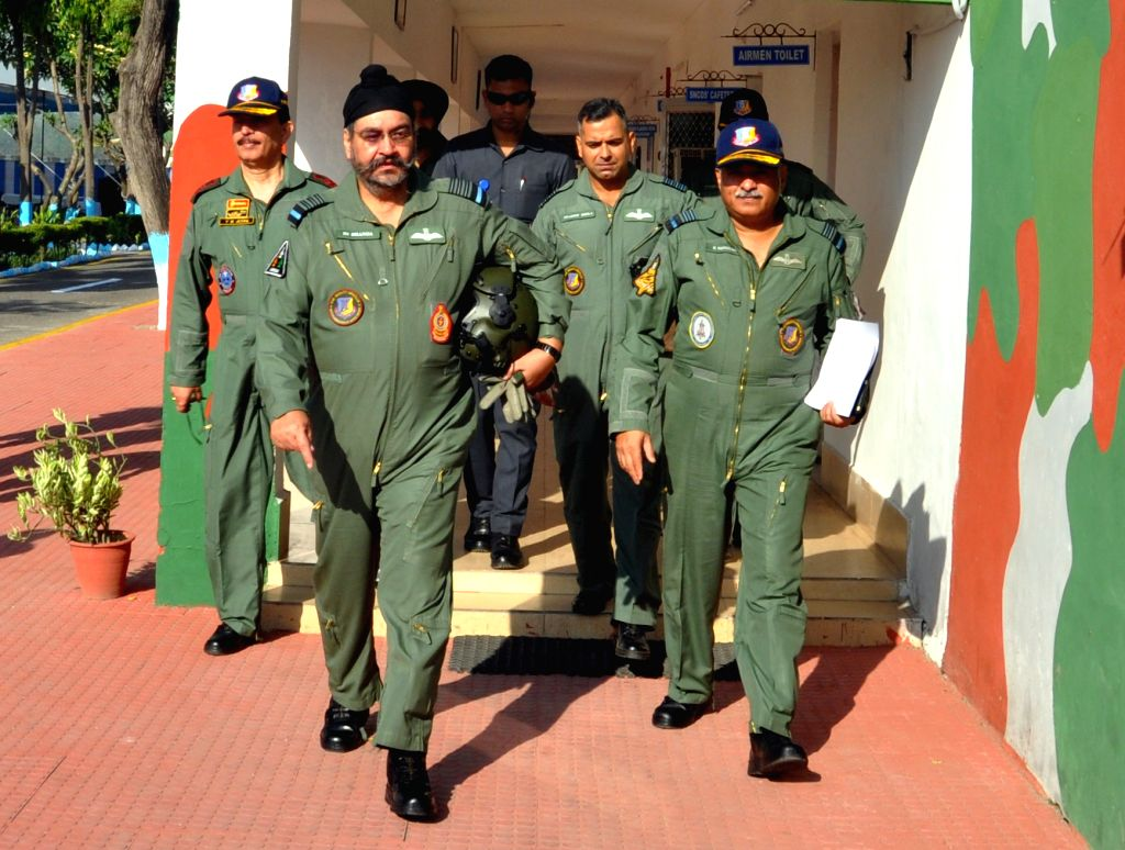 Chief of the Air Staff, Air Chief Marshal B.S. Dhanoa and Air Officer Commanding-in-Chief Western Air Command Air Marshal R. Nambiar walk towards the aircraft with formation members ...