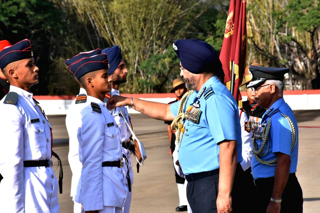 Chief of the Air Staff Air Chief Marshal B.S. Dhanoa presents medals to the winners during the Passing Out Parade of 136th Course at the National Defence Academy at Khadakwasla in ...