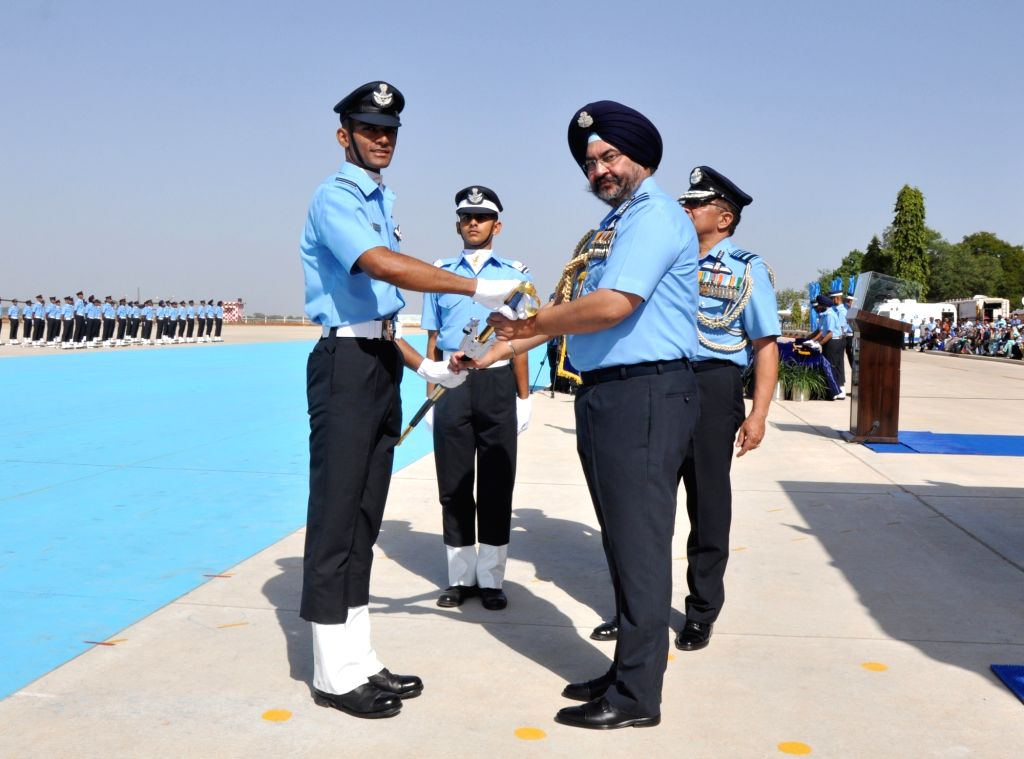 "Chief of the Air Staff Air Chief Marshal B.S. Dhanoa presents the Chief of the Air Staff ""Sword of Honour"" for standing first in overall merit in the Pilots??? Course to Flying ..."