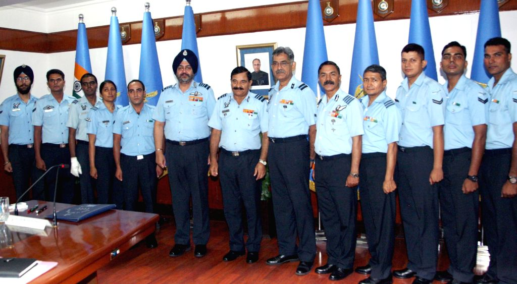 Chief of the Air Staff, Air Chief Marshal BS Dhanoa with the mountaineering expedition team during flag-in ceremony in New Delhi on June 23, 2017.