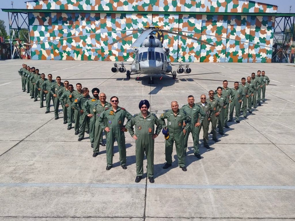 Chief of the Air Staff, Air Chief Marshal BS Dhanoa along with the personnel of 152 Helicopter Unit during the ???Missing Man??? formation sortie to commemorate the supreme sacrifice of ...