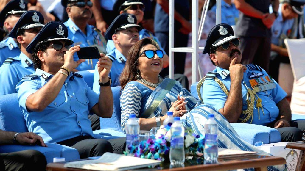 Chief of the Air Staff, Air Chief Marshal Rakesh Kumar Singh Bhadauria and Cricket legend and honorary Group Captain Sachin Tendulkar during the 87th anniversary celebrations of the Indian ... - Sachin Tendulkar