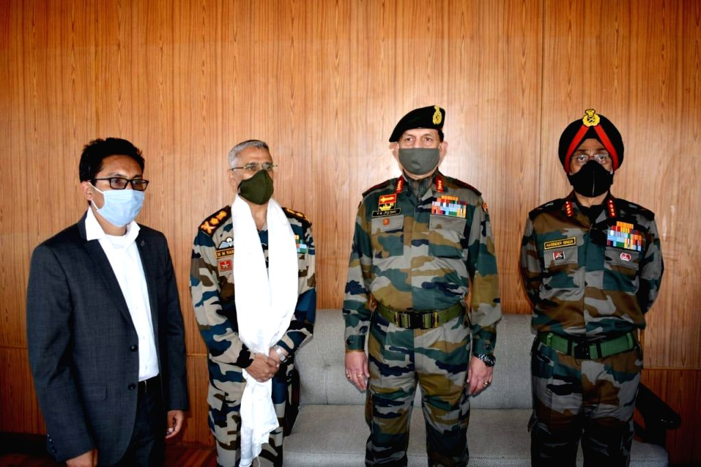 Chief of the Army Staff (COAS) General Manoj Mukund Naravane meets BJP MP from Ladakh Jamyang Tsering Namgyal in Leh during his two day visit to Eastern Ladakh, on June 23, 2020.