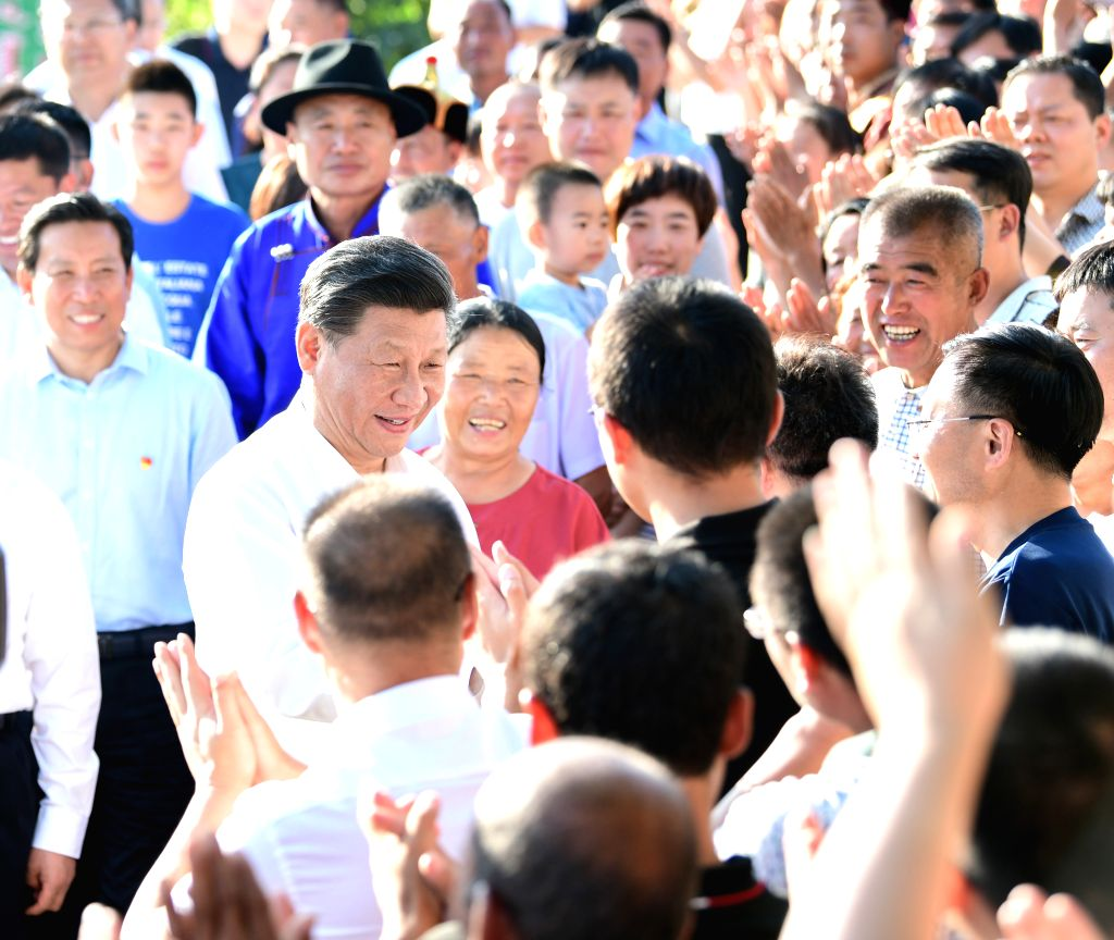 CHIFENG, July 15, 2019 - Chinese President Xi Jinping, also general secretary of the Communist Party of China (CPC) Central Committee and chairman of the Central Military Commission, shakes hands ...