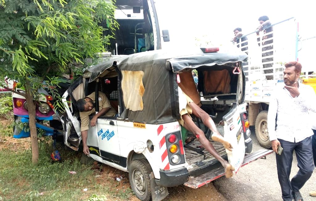 Chikkaballapur: The site of collision between a private bus and a goods carrier van on a state highway at Murugamalla village near Chintamani town in Karnataka's Chikkaballapur district, on July 3, 2019. At least 12 people, including three women, die