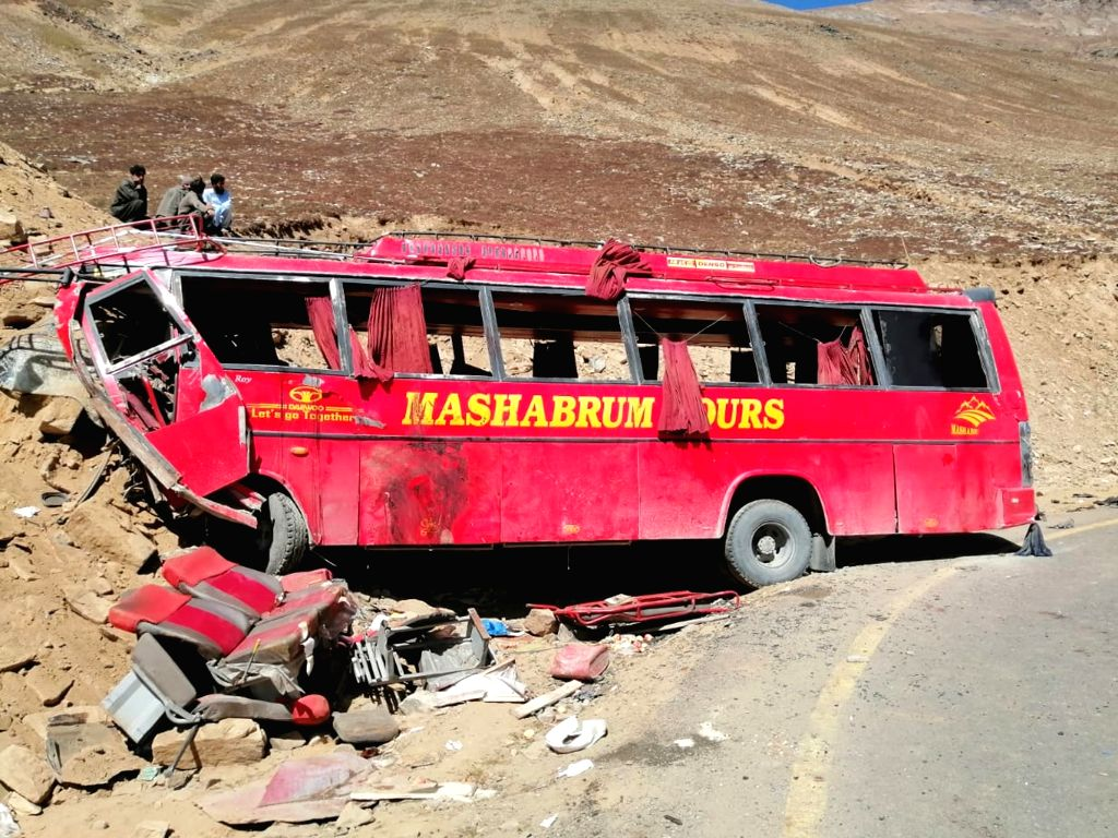 CHILAS, Sept. 22, 2019 - Photo taken with mobile phone shows a damaged bus at a road accident site in northern Pakistan, Sept. 22, 2019. At least 26 people were killed and 19 others injured when a ...