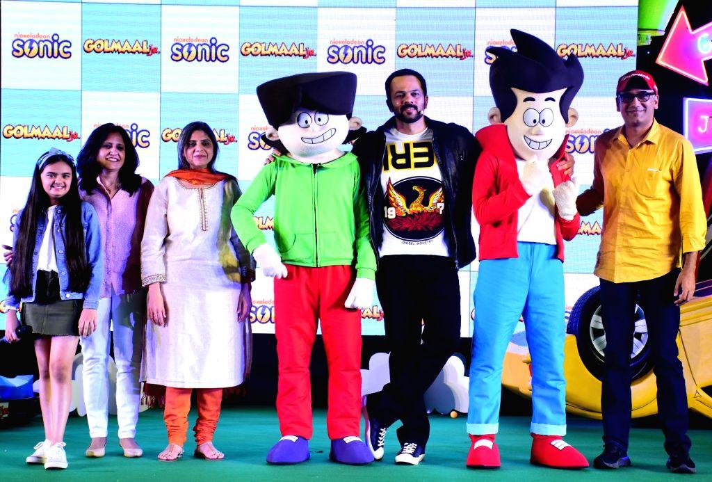 Child actor Ruhanika Dhawan, Viacom18 Kids Entertainment Cluster Head (Content) Anu Sikka, Viacom18 Hindi Mass Entertainment and the Kids TV Network Head Nina Jaipuria, filmmaker Rohit ... - Ruhanika Dhawan and Rohit Shetty