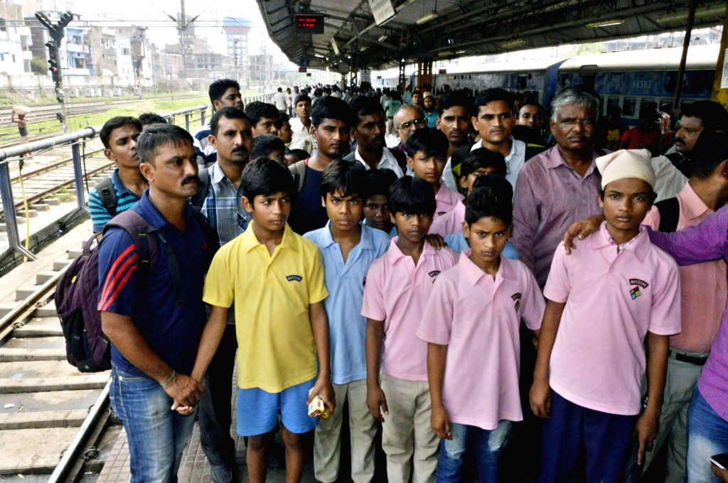 Child labours from bihar leave for their homes by a train after they were rescued during operation in Mumbai at Patna on August 02, 2014.