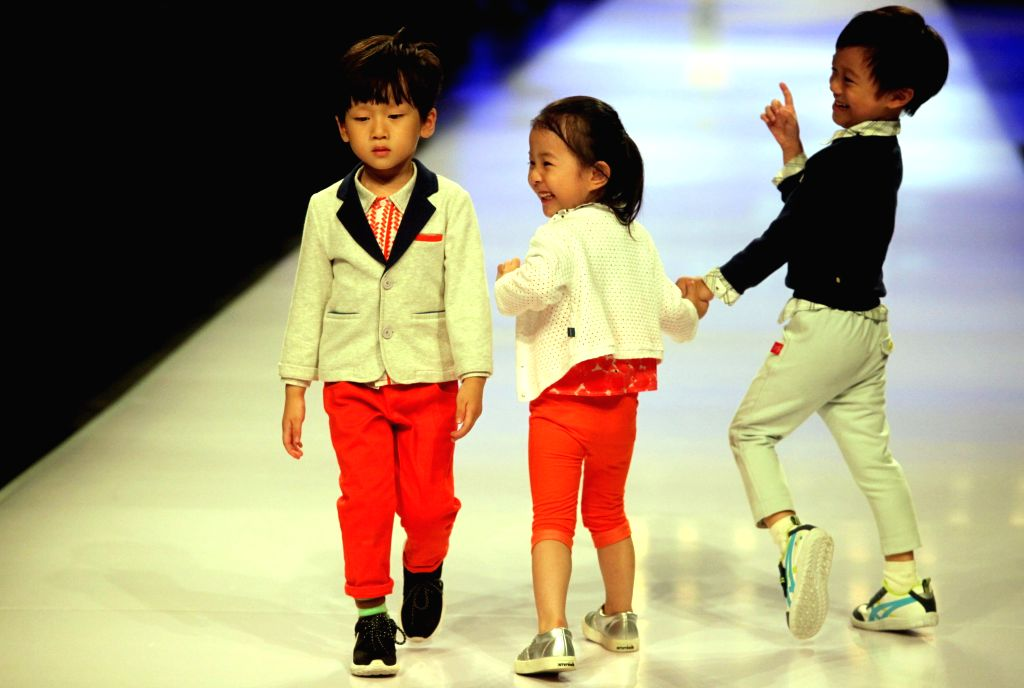 Child models present creations during the Shanghai Fashion Week in east China's Shanghai, Oct. 21, 2015.