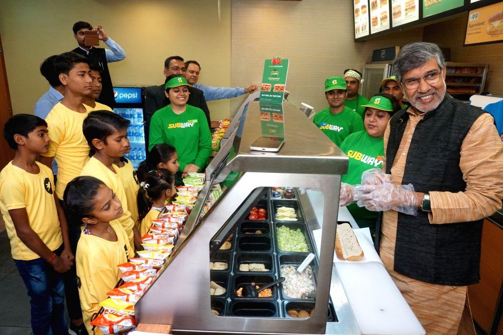 Child Rights activist and Nobel laureate Kailash Satyarthi creating new sandwich recipe to kick off the World Sandwich Day 2018 festivities at Subway in Gurugram on Oct 24, 2018. World ... - Kailash Satyarthi
