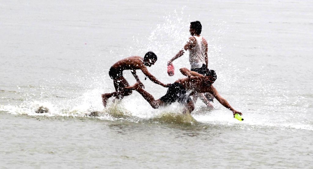 Children beat the heat at Sangam on a hot day in Allahabad on June 6, 2017.