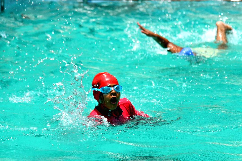 Children beat the heat in a swimming pool in Bengaluru on April 21, 2016.