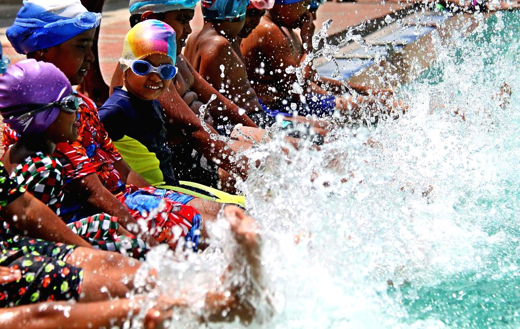 Children beat the heat in a swimming pool in Bengaluru on April 21, 2016.