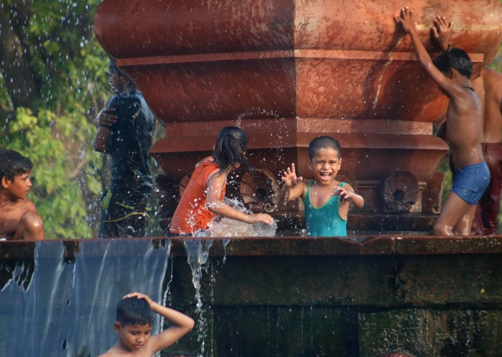 Children beat the heat on a hot day in New Delhi on June 3, 2016.