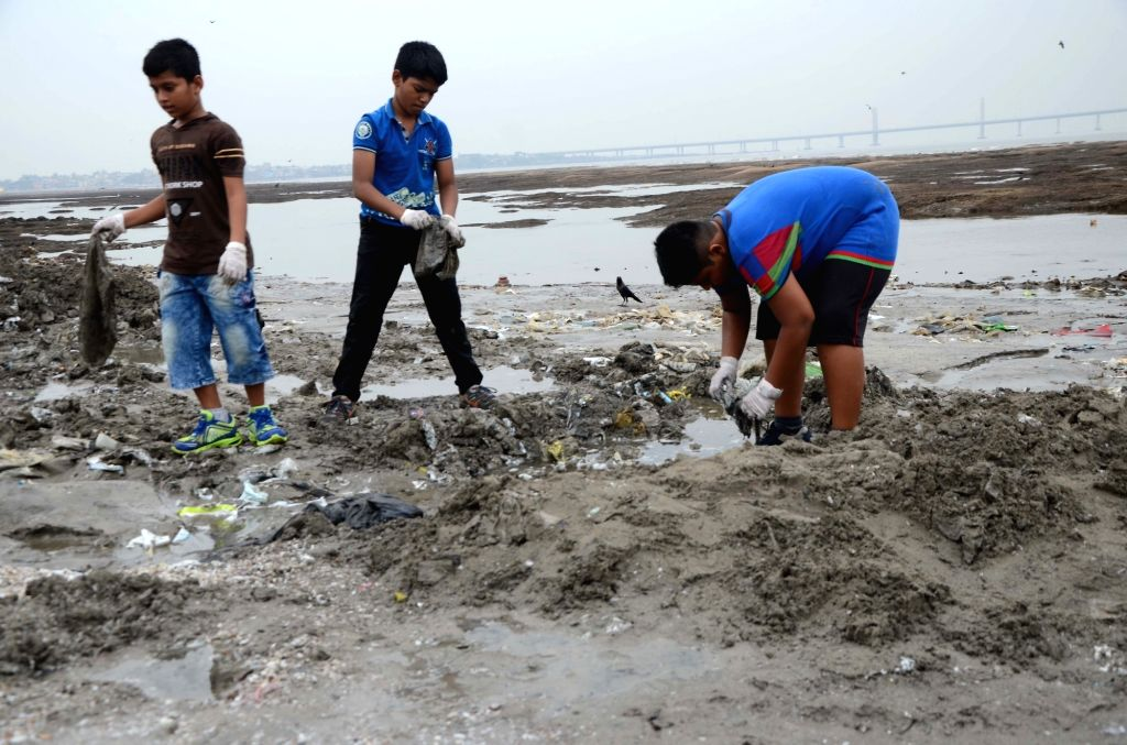 Children busy cleaning Dadar beach on World Environment Day in Mumbai, on June 5, 2018.