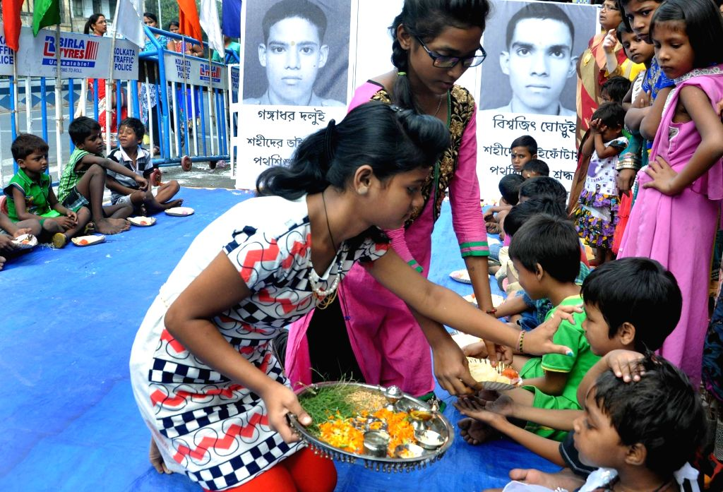 "Children celebrate ""Bhai Phonta"" - a Hindu festival where the sisters mark the foreheads of their brothers with sandalwood paste and pray for their safety, well being and success, ..."