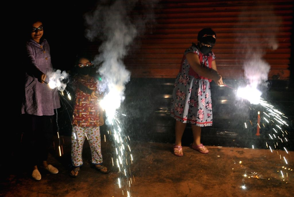 Children celebrate Diwali with fire crackers in Kolkata on Oct 27, 2019.