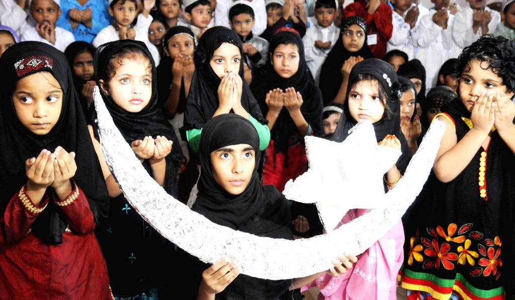 Children celebrate during a Eid Milan programme in Patna on July 26, 2014.