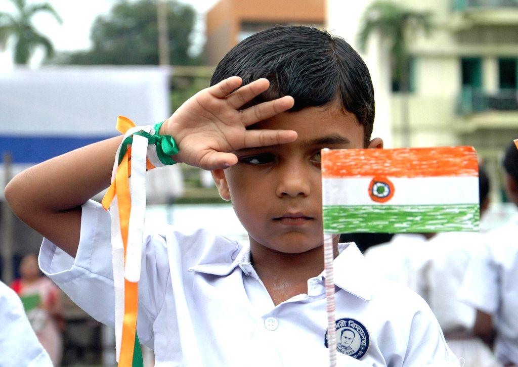Children celebrate Independence Day in Kolkata on Aug 15, 2014.
