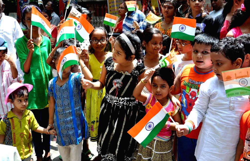 Children celebrate Independence Day in Kolkata, on Aug 15, 2016.