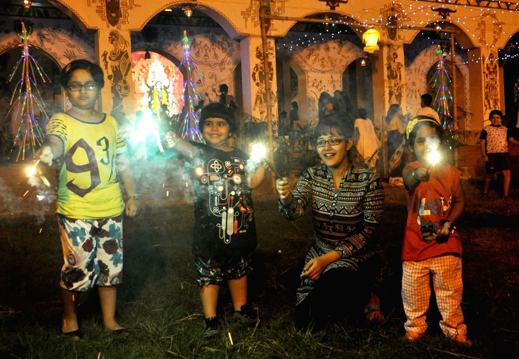 Children celebrate Kali Puja in Kolkata on Oct 29, 2016.