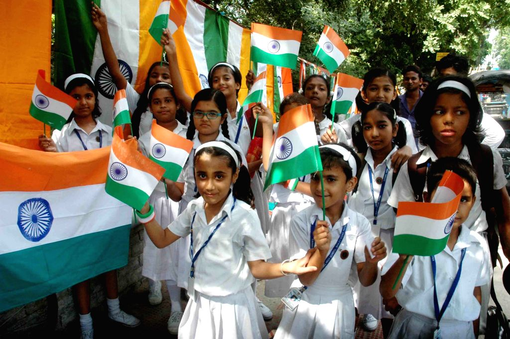 Children celebrate on the eve of Independence Day in Patna on Aug, 14, 2015.