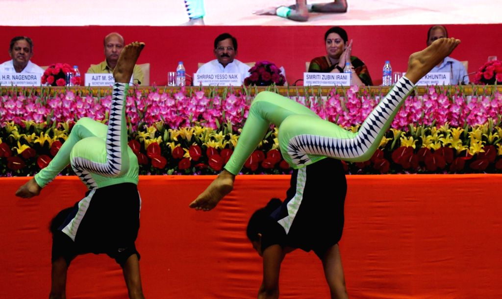Children demonstrate yoga asans  during National Yoga Olympiad - award ceremony in New Delhi, on June 20, 2016.