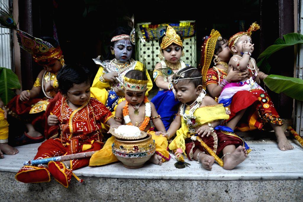 Children dress up as Lord Krishna during Janmashtami festivities on the eve of the festival, in Kolkata on Sept 2, 2018.