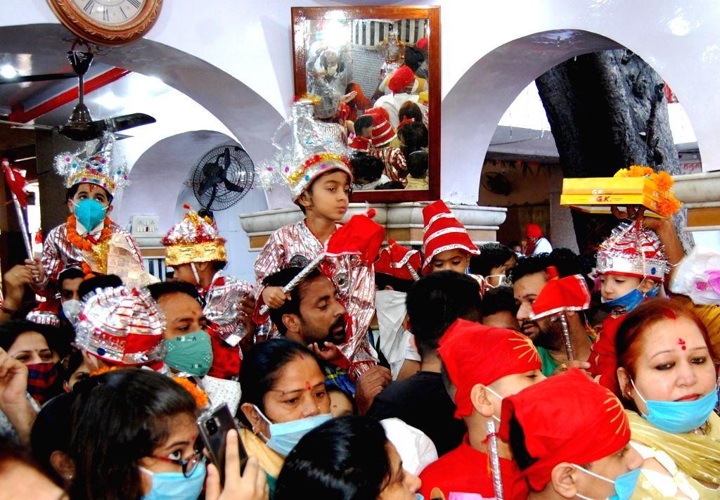 Children dressed up as Lord Hanuman visit Bara Hanuman Temple with their parents during 'Langoor Wala Mela' organised on the first day of Navaratri, in Amritsar on Oct 17, 2020.